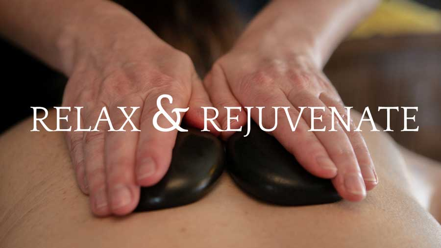 Relax & Rejuvenate with a massage from Donna Back Therapies, image here showing hot stone massage